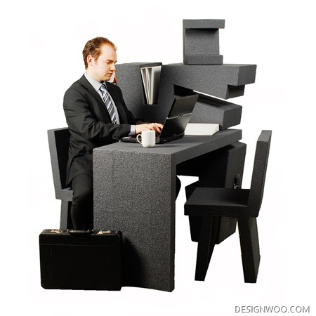 A Mobile Office Made Up Of A Desk And Two Chairs
